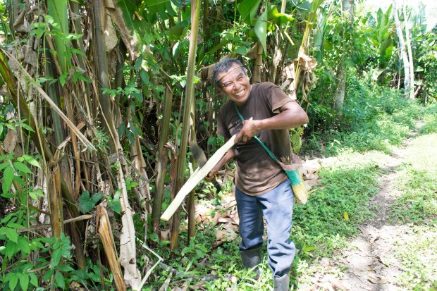 [Eladio talks to us excitedly as he gets ready to share his sugarcane with us]